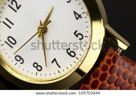 Dial of classical wrist watch close-up. - stock photo