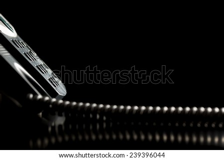 Dial-up buttons on the keypad of a landline telephone instrument over black background. Conceptual of customer service or customer support. - stock photo