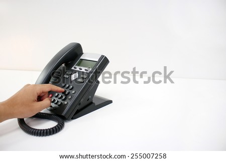Dialing telephone with copy space - stock photo