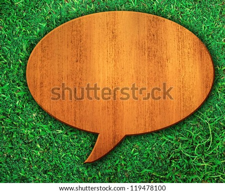 dialog wood board on grass - stock photo