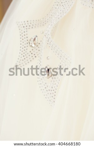 Diamond  at luxury wedding dress - stock photo