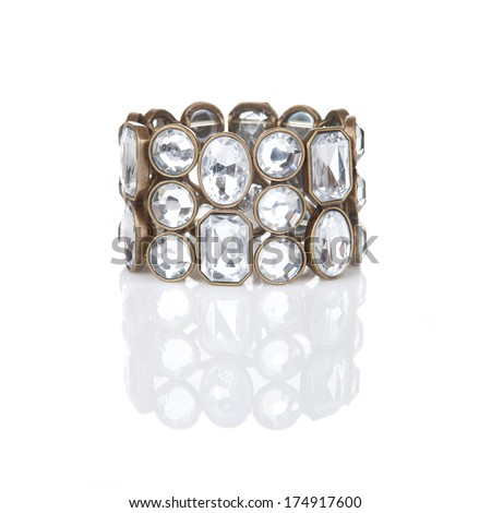 Diamond bracelet isolated on white with reflection - stock photo