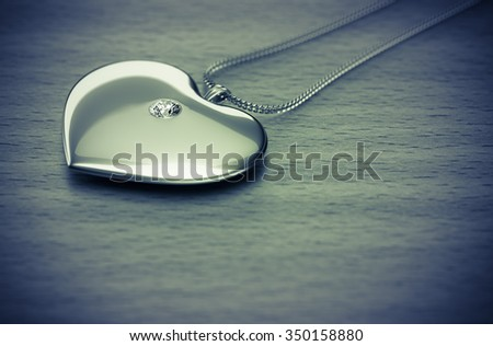 Diamond heart necklace on the table 3d rendering. - stock photo