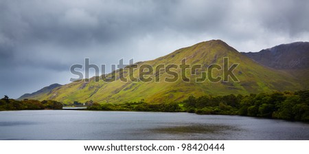 Diamond hill and Kylemore lake in summertime before the storm, county Galway, Ireland. - stock photo