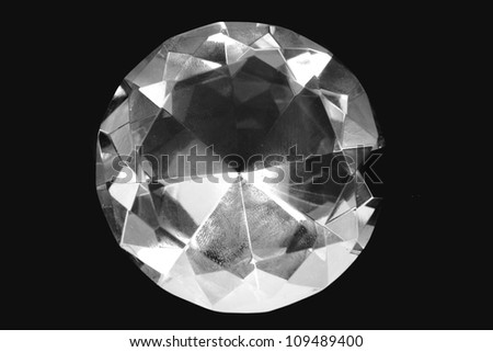 diamond isolated on the black background - stock photo