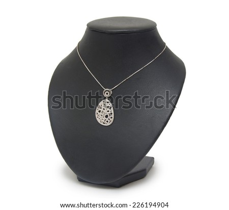 Diamond necklace on black mannequin isolated on white background - stock photo
