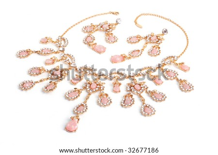Diamond pendant with pink gems isolated on white - stock photo