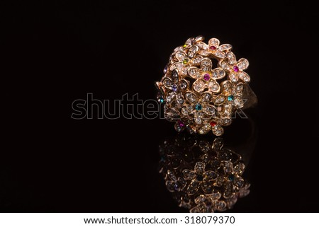 Diamond ring in a row in the form of flowers