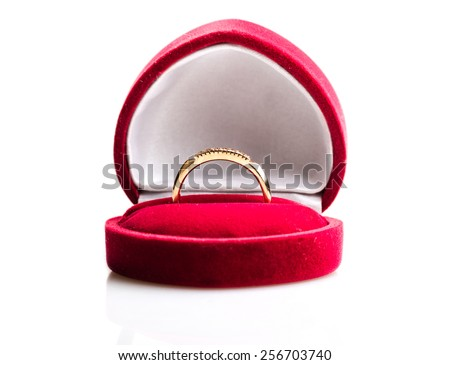 diamond ring in a velvet red box  - stock photo