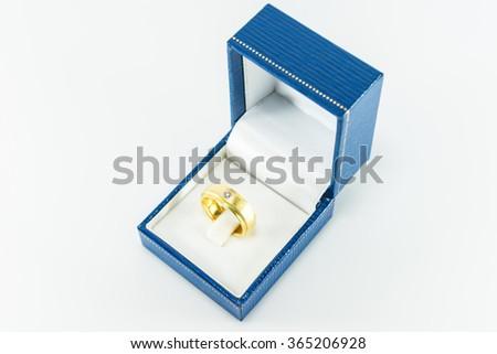 Diamond ring in Blue Box on white background. - stock photo