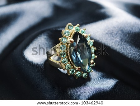 Diamond ring on blue silk - stock photo