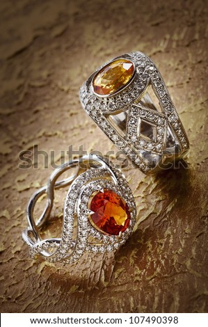 Diamond rings with gems - stock photo