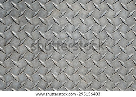 Diamond Tread Plate. Picture of dirty and heavily worn metal diamond tread plate.