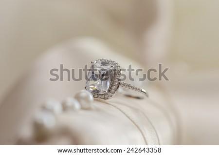 Diamond wedding ring  against light blurred background  - stock photo