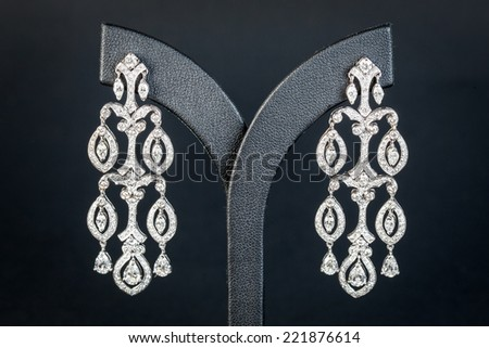 Diamonds Earring in black background - stock photo