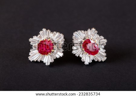 Diamonds Earring with ruby gem in black background - stock photo