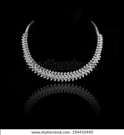 diamonds necklace shot against  a black background  - stock photo