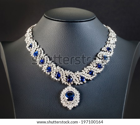 diamonds with dark blue sapphire necklace on the black background - stock photo