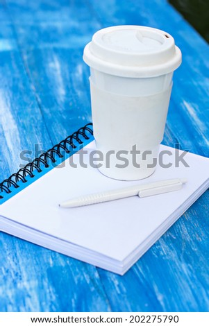 diary, a glass of coffee and  pen on the table - stock photo
