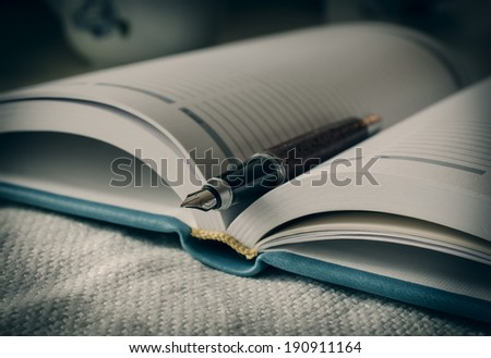 Diary and fountain pen. Macro. Selective focus. - stock photo