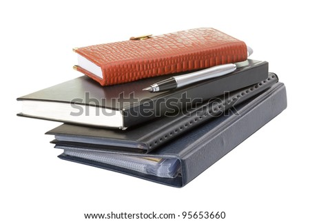 Diary and pen isolated ob a white background - stock photo
