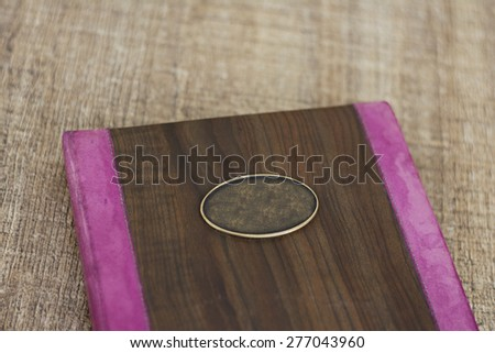 Diary book. Photographed indoors, on a bright brown table. - stock photo