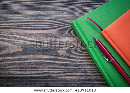 Diary books pen on vintage wooden board education concept. - stock photo