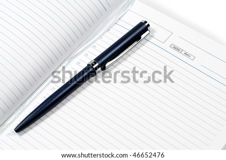 Diary for records and a pen on a white background