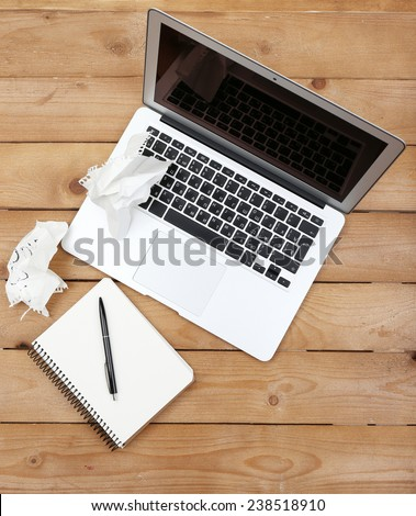 Diary with crumbled papers near the notebook on wooden background, top view - stock photo
