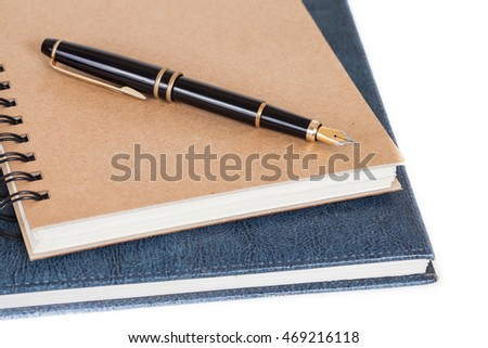 Diary with  pen isolated on white background