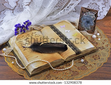 Diary with picture in metal frame - stock photo