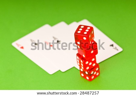 Dice and 4 aces on green background - stock photo