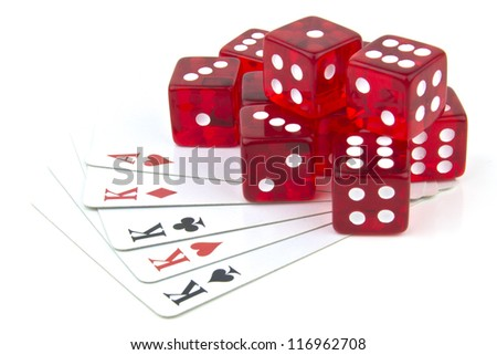 dice and cards scattered on table - stock photo