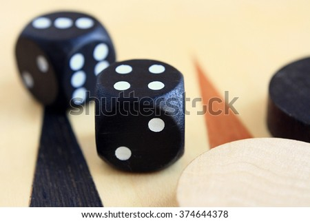 Dice and checkers on the playing field for a game of backgammon. - stock photo
