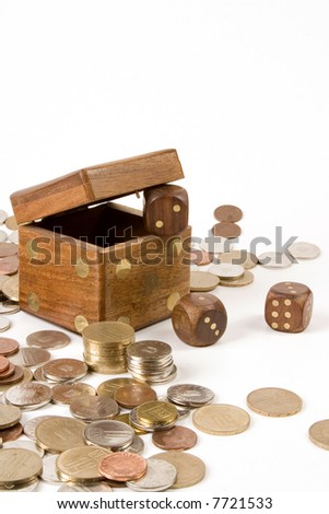 Dice and coins on white background