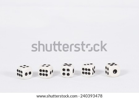Dice are lined up in one row at the bottom of the background/ Dice on white background - stock photo