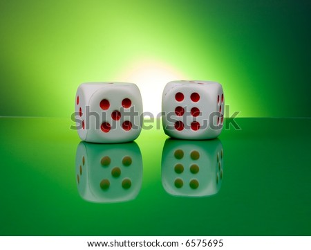 Dice in gambling table reflections