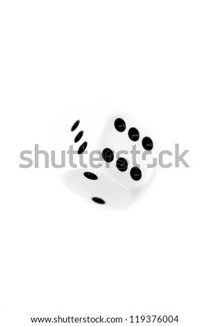 Dice in motion against a white background - stock photo