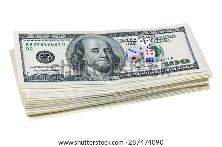 Dice lying on the stack of 100-dollar bills, isolated on white background - stock photo