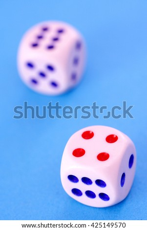 Dice on a blue background - stock photo