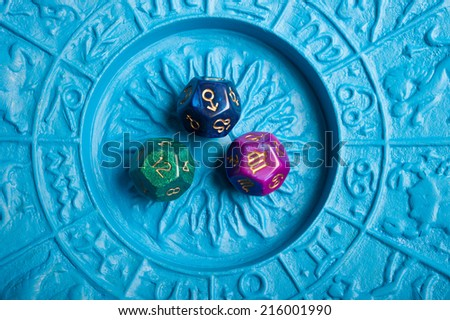 dice on an astrological plate - stock photo