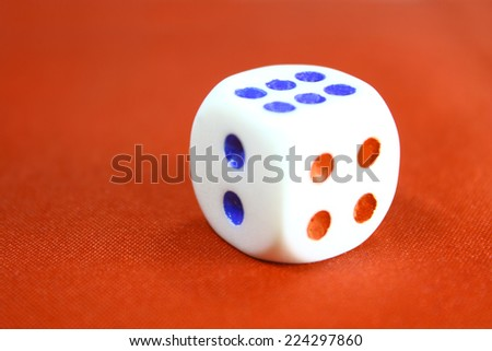 Dice on red background - stock photo