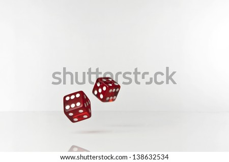 Dice rolling on plain white background