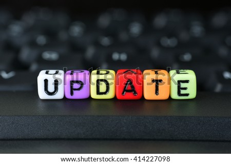 Dice With Word Update On Keyboard - stock photo