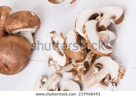 Diced and whole agaricus brown button mushrooms, also known as portobello as they increase in size, ready to be used as a savory cooking ingredient or in vegetarian and vegan cuisine