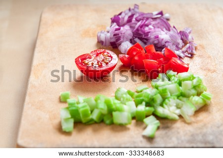 diced red onion, cherry tomatoes and green celery