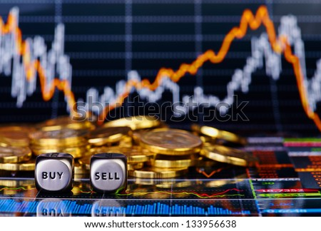 Dices cubes with the words SELL BUY, golden coins and a financial chart as the background. Selective focus - stock photo