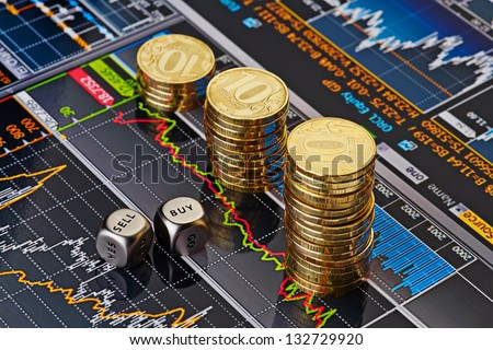 Dices cubes with the words SELL BUY, uptrend stacks of golden coins. Financial chart as background. Selective focus.
