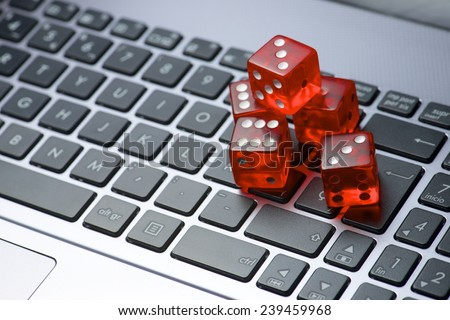 Dices group stacking on a laptop - stock photo