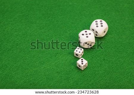 dices on a green felt table - stock photo